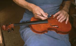 luthier geste pour carnet